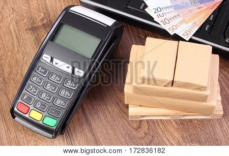 Payment Terminal, Currencies Euro, Laptop And Wrapped Boxes On Wooden Pallet