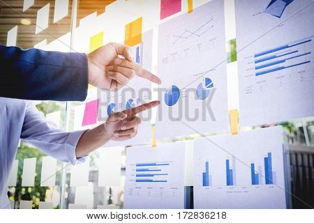 Businessman Making Presentation With His Colleagues And Business Strategy Digital Layer Effect At Th