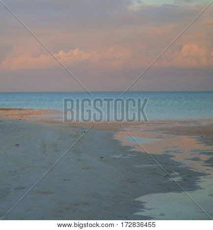 Low tide at sunrise at Isla Blanca Park bayside outside Cancun, Mexico.