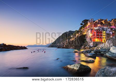 Riomaggiore town cape and sea landscape at sunset. Seascape in Cinque Terre National Park Liguria Italy Europe. Long Exposure