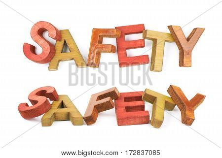Word Safety made of colored with paint wooden letters, composition isolated over the white background, set of two different foreshortenings