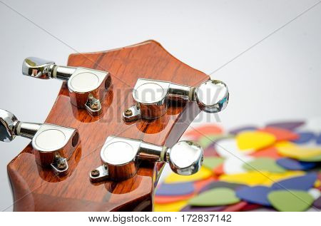 music background acoustic guitar ukulele and colorful pick