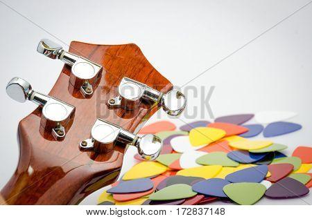 music background acoustic guitar ukulele and colorful pick