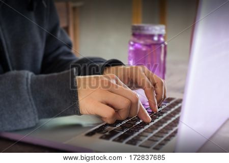 Violet items on wooden working table stock photo