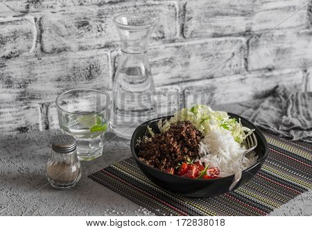 Beef taco rice and cabbage salad on a gray background. Delicious lunch