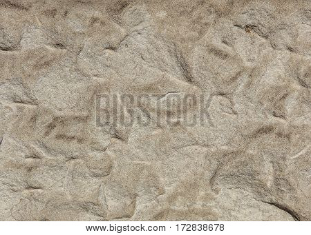 Surface of an old handmade stone block background/texture.