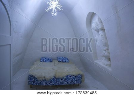 KEMI, FINLAND - FEBRUARY 18, 2017: Unique beautifully decorated snow room in Snow Hotel at LumiLinna Snow Castle in Kemi, Finland. Snow Hotel is the World Luxury Hotel Global Award Winner