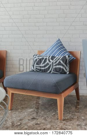 Dark Blue Upholstered Chair With Pillows In The Living Room