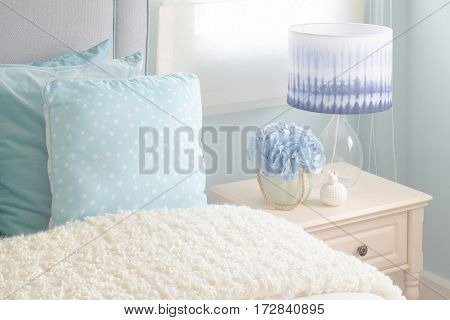 Light Blue Pillows And Cream Puffy Blanket In Light Blue Interior Bedroom