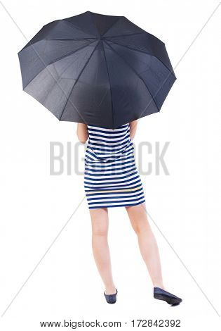 young woman in a striped dress under an umbrella. Rear view people collection.  backside view of person.  Isolated over white background. young girl standing down his leg back.