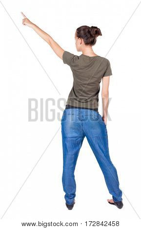 Back view of  pointing woman. beautiful brunette  girl in jeans.  Rear view people collection.  backside view of person.  Isolated over white background.