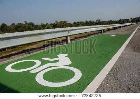 Bicycle Sign Or Icon On The Road In The Dam.