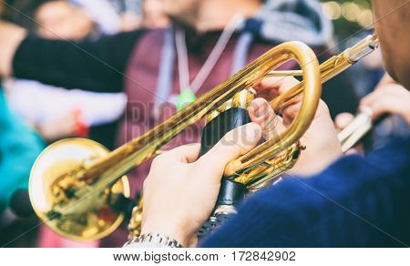 Musician playing a brass trumpet