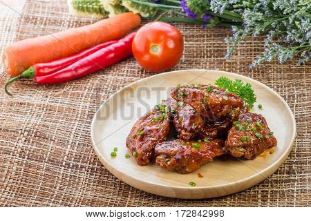 Buffalo Chicken Wings With Barbecue Sauce,drumsticks And Vegetables Close Up On Wooden Tray Shot Tha