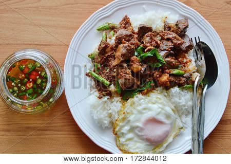 spicy stir fried chicken entrails curry and egg with fish chili sauce cup