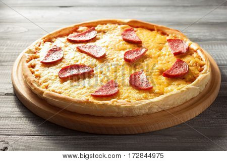 pepperoni pizza at wooden table