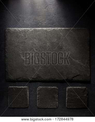 slate signboard at black background texture