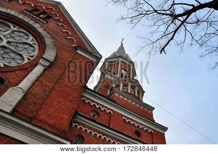 Looking up at the red brick church of St. Adalbert in Bialystok, Poland.