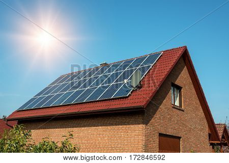 Solar panel on a red roof -  concept of sustainable resources