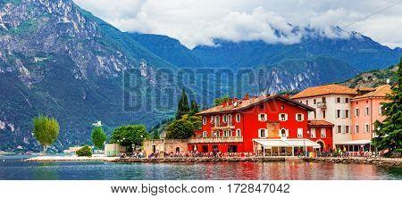 Alpine scenery - beautiful lake Lago di Garda and village Torbole, Italy