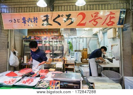 man slice fresh salmon fish taken at Tsukiji Fish Market in Tokyo on 2 December 2016