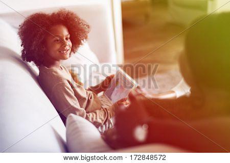 Little african girl using digital tablet