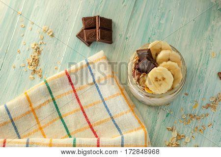 Yogurt With Muesli And Banana In Small Jar