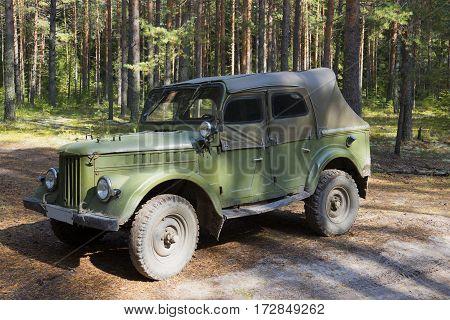 LENINGRAD REGION, RUSSIA - SEPTEMBER 06, 2013: GAZ-69 at the edge of the summer forest