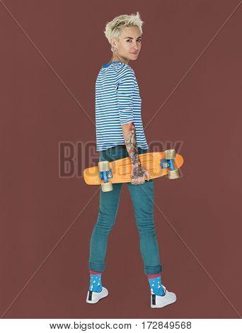 Caucasian Blonde Woman Holding Skateboard