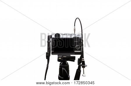 Digital camera on camera tripod, isolated on white background with copy space