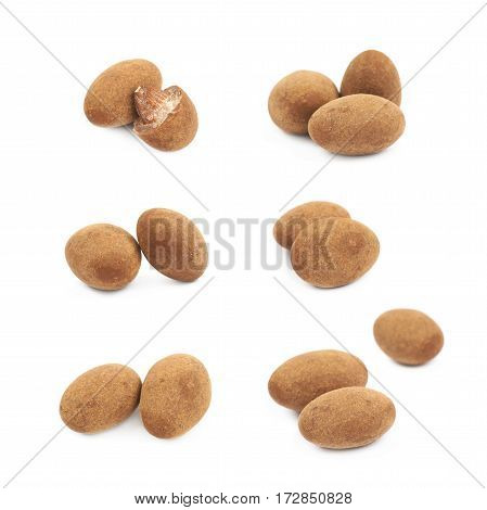 Few chocolate coated almond nuts isolated over the white background, set of six different foreshortenings