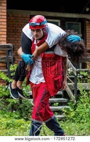 Rescue Worker Evacuate Female Victim