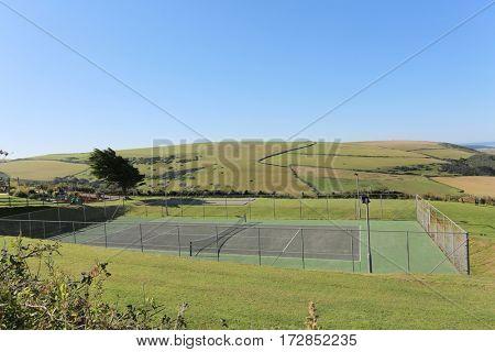 empty grasscourt or all weather tennis court in the summer, uk