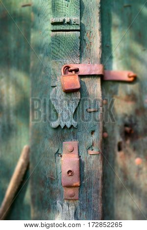 old rusty padlock on a blue door