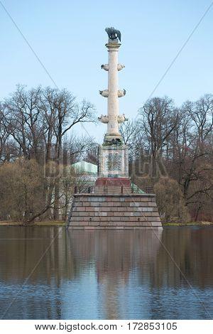 SAINT-PETERSBURG, RUSSIA - APRIL 17, 2016: Cesme column on the Big Pond cloudy April afternoon. Catherine Park. Tsarskoye Selo