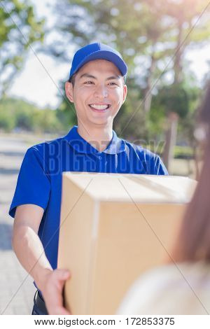 deliveryman stand and smile to you asian