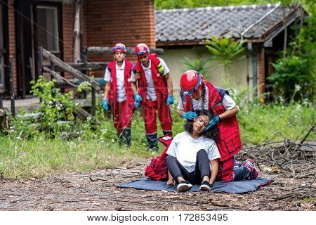 Rescue team helping injured female victim color image