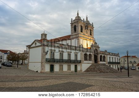 The Church of Nossa Senhora da Nazare (Church of Our Lady of Nazare) is an imposing church located on the hilltop O Sitio overlooking Nazare Portugal poster