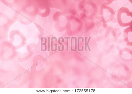 Valentine's day abstract background of soft pink white bokeh blur hearts. Festive valentine backdrop.