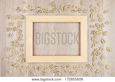 Italian dry sea pasta on beige brown wooden board with empty copy space as decorative frame background. Mock up restaurant menu.