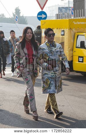 MILAN ITALY - FEBRUARY 22: Fashionable people pose outside Gucci fashion show building during Milan Women's Fashion Week on FEBRUARY 22 2017 in Milan.