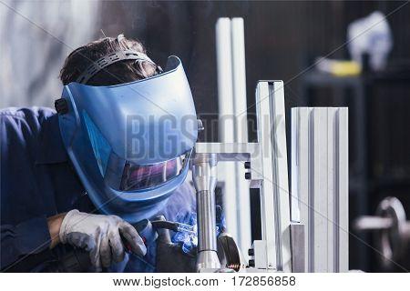 Professional craftsman constructing bike details at workshop
