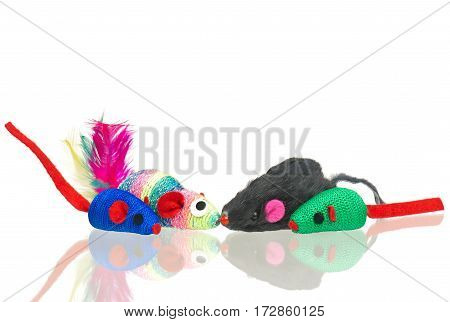 Bright toy mice for little kitten isolated on white background