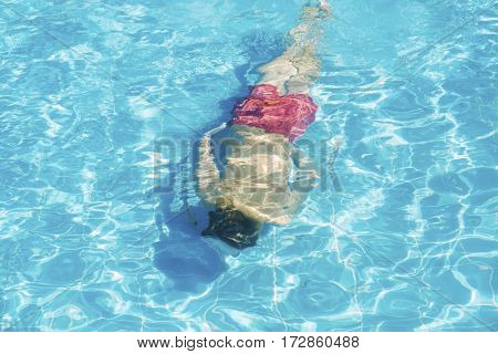 Person floats under water in the pool