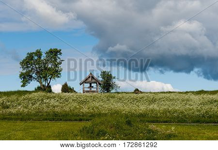 Scenery of Kizhi on a Sunny day with clouds with a cross on the hill