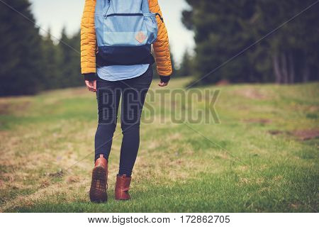 Girl walking in the nature / hiking.