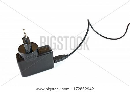 An universal charge device for domestic electronics on four ports is isolated on a white background