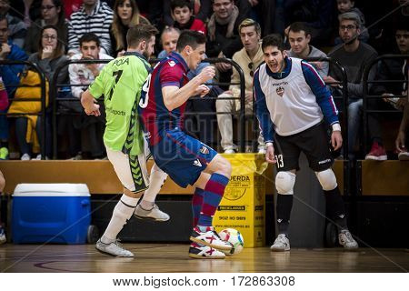 VALENCIA, SPAIN - FEBRUARY 19: Pizarro with ball and Pola during Spanish league match between Levante UD FS and Movistar Inter at Cabanyal Stadium on February 19, 2017 in Valencia, Spain