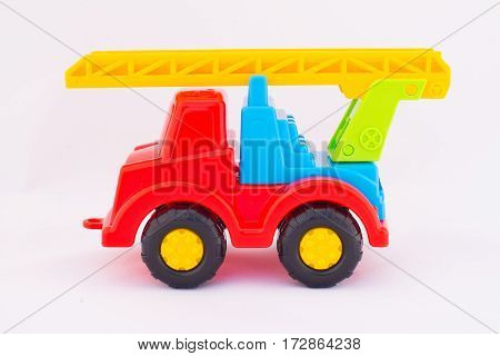 Children's toy colorful car on a white background