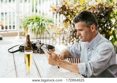 Man Having A Drink At The Bar